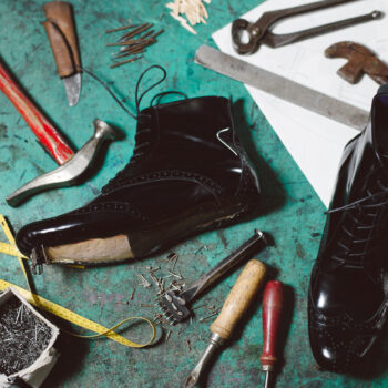 Image of shoe being repaired and the tools used for repairing.