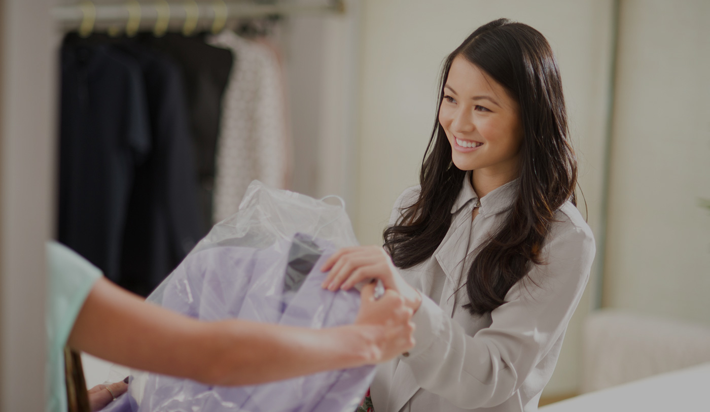 Photo of a woman picking up dry cleaning