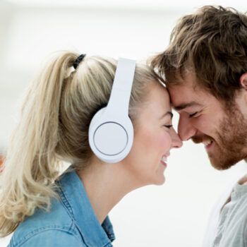 Girl wearing headphones with boyfriend