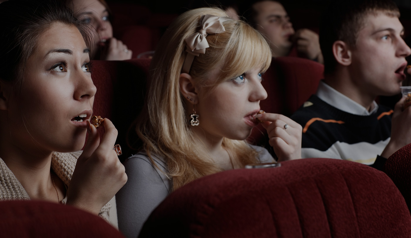 Photo of a woman in a movie theatre