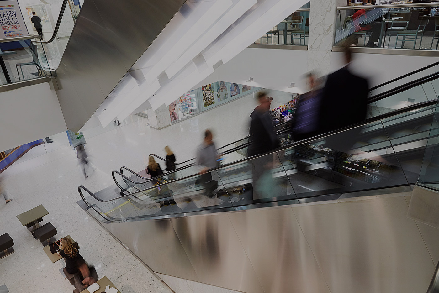 Photo of people on an escalator