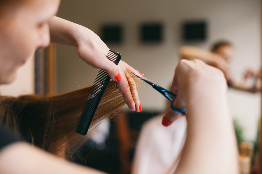 Female hairdresser while working.