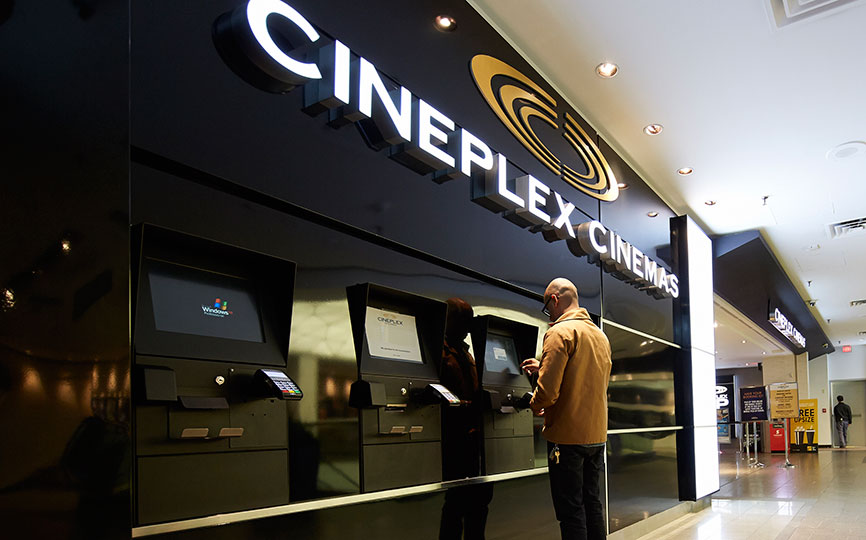 Man buying movie ticket at Cineplex