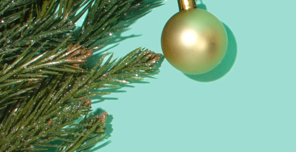 greenery and gold ornament on teal background
