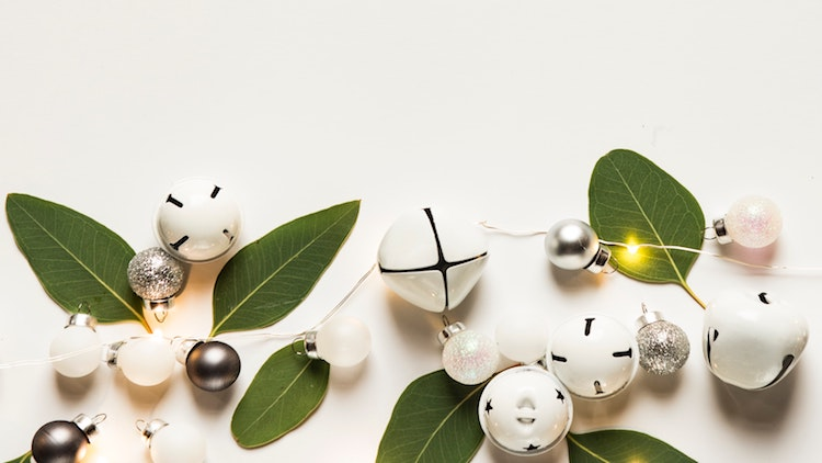 bells and greenery on white background